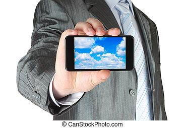бизнесмен, holds, умная, телефон, with, облако, вычисления, концепция, на, белый, задний план