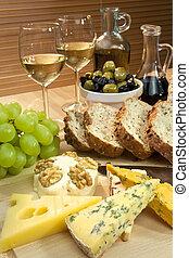, блюдо, of, средиземное море, питание, including, сыр, виноград, белый, вино, хлеб, olives, оливковый, масло, and, бальзамический, vinegar., выстрел, в, красивая, тепло, легкий, with, , фокус, на, , сыр, в, , foreground.