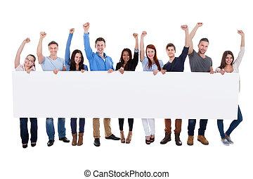 в восторге, группа, of, разнообразный, люди, держа, баннер