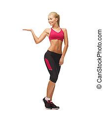 женщина, в, спортивная одежда, with, пустой, рука