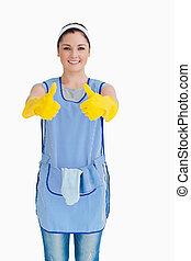 женщина, giving, вверх, желтый, gloves, уборка, thumbs