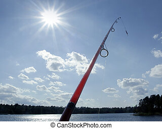 озеро, ловит рыбу