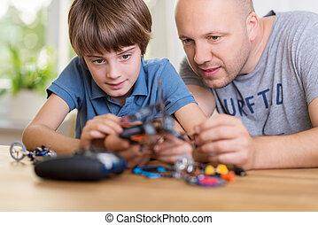 отец, помощь, his, сын, строить, , модель, игрушка