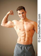 портрет, of, мускулистый, спортивный, человек, он, shows, his, бицепс