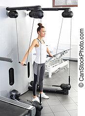 реабилитация, and, exercises, of, , молодой, женщина, на, , обучение, машина, with, , load.