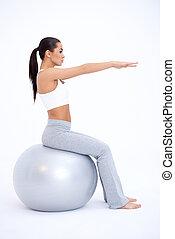 сексуальный, поместиться, женщина, сидящий, на, большой, упражнение, мяч