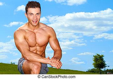 спортивный, мускулистый мужчина, в, поле
