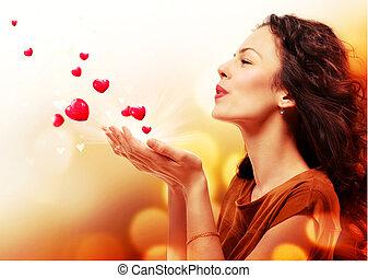 אישה, לנשוף, לבבות, מ, שלה, hands., רחוב., יום של ולנטיינים, מושג