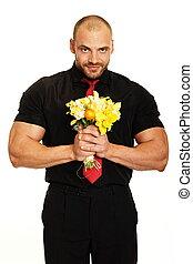 איש גדול, עם, פרחים