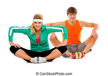 כושר גופני, אישה צעירה, ו, איש, ב, בגדי ספורט, לעשות, למתוח תרגיל, ב, רצפה
