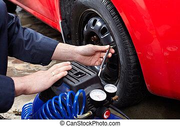 מכונאי של מכונית, להשתנות, a, tire.