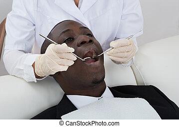 רופא שניים, לבחון, שיניים, של, חולה