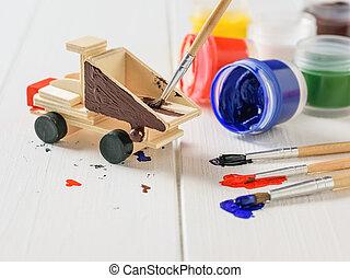 おもちゃ, プロセス, 木製である, トラック, 白, テーブル。, 飾り付ける