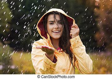 かなり, 若い女性, 中に, 黄色のレインコート