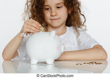 かわいい, わずかしか, コイン, セービング, 巻き毛, 銀行, 大きい, 上に, 白, バックグラウンド。, パッティング, 小豚, お金, 女の子, 教育, concept.