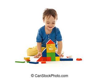 かわいい, 小さい 男の子, ある, 遊び, ∥で∥, カラフルである, 建物, 木製のブロック, 隔離された, 白