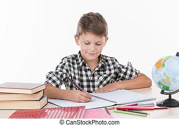 かわいい, 男の子のモデル, テーブル, そして, writing., ハンサム, わずかしか, 男生徒, 勉強, 白, 背景