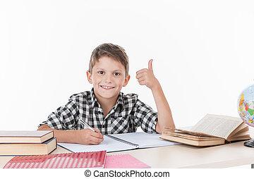 かわいい, 男の子のモデル, テーブル, そして, writing., ハンサム, わずかしか, 男生徒, 提示, 「オーケー」, 白, 背景