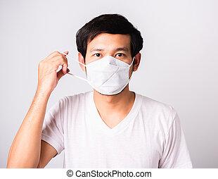 に対して, 布, coronavirus, 衛生学, 身に着けているマスク, 保護である, 顔, 外科, 人