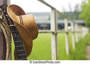 カウボーイ帽子, そして, ギター