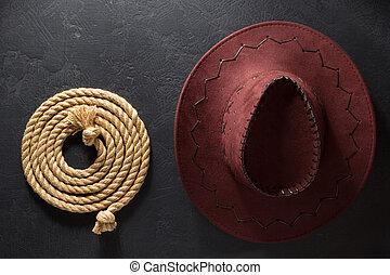 カウボーイ帽子, そして, lasso, 上に, 黒い背景