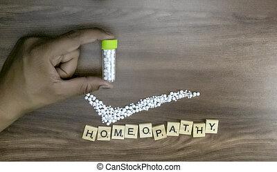 カチカチいいなさい, 概念, びん, テキスト, 印, 木, 背景, 保有物, 薬, 小球体, ホメオパシーである, 手, ホメオパシー, main