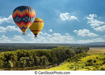 カラフルである, 上に, 飛行, 空気, フィールド, 暑い, 緑の気球