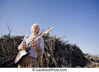 ギター プレーヤー, 電気である, 屋外で