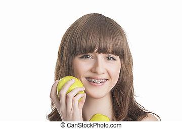 コーカサス人, デモをする, 女の子, ブラケット, 上に, 若い, 隔離された, apples., バックグラウンド。, 緑, イメージ, 歯, 横, 白, 幸せ