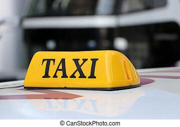 バックグラウンド。, 黄色, 黒, テキスト, タクシー, ぼんやりさせられた, ∥あるいは∥, 屋根, タクシー, 通りの 印, 色, 車ライト