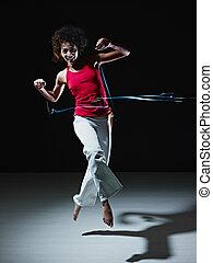 ヒスパニックの 女性, ダンス, そして, 跳躍, ∥で∥, ライト