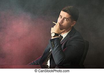 ビジネスマン, 煙が出ているタバコ