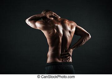 ビューを支持しなさい, の, 若い, アフリカ, スポーツ, 人, 感じの苦痛, 中に, 彼の, 背中