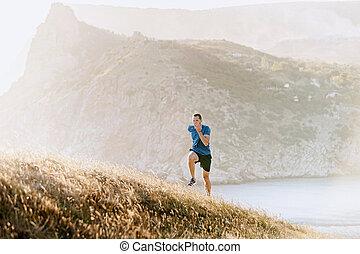 ランナー, 坂の上へ, 走っている男性