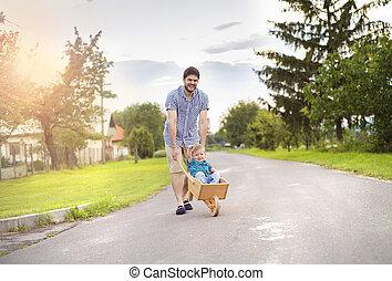 一輪手押し車, 彼の, 父, 押す, 息子