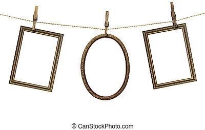 三, 畫框架, 暫停執行在上, clothespins, 被隔离, 在懷特上, 背景