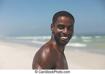 人間が立つ, よく晴れた日, 浜