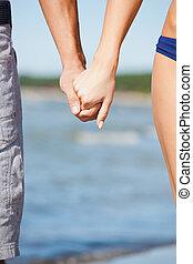 人 と 女性, 手を持つ