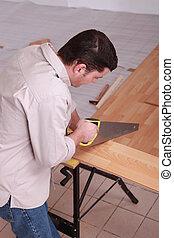 人, のこぎりで切る, 板, の, 寄せ木張りの床
