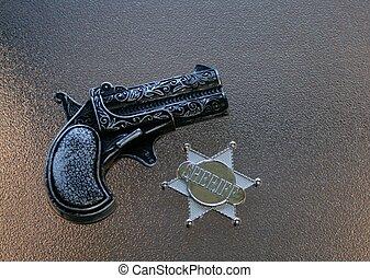 保安官のバッジ, 銃