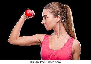 保持, 她, 身體, fit., 運動, 年輕婦女, 行使, 由于, dumbbell, 當時, 站立, 針對, 黑色的背景