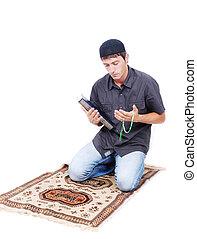 保有物, muslim, 伝統的である, qoran, 本, 方法, 西洋ヒイラギ, 祈ること, 人