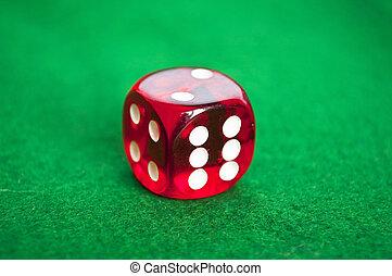 单一, 红, 骰子, 在上, 绿色的背景