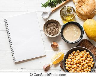 原料, 料理, 執筆, 手製, space., 白, hummus, ノート, セット, レシピ, 木, コピー, バックグラウンド。, 伝統的である
