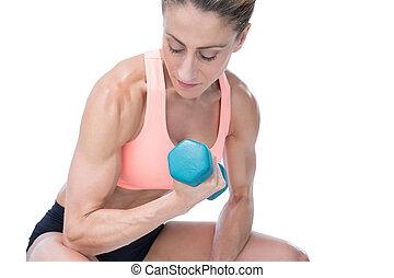 堅強的婦女, 做, bicep 卷發, 由于, 藍色, dumbbell