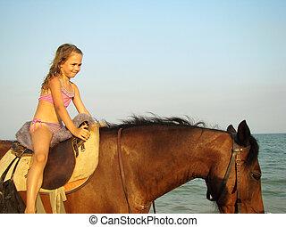 女の子, 馬の背