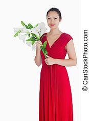 女性の保有物, ユリ, 中に, a, 赤いドレス