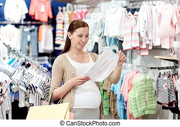 女性買い物, 妊娠した, 洋服屋, 幸せ