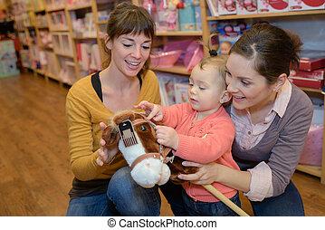 女性, 購入, おもちゃ, 中に, おもちゃ屋