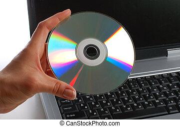 。, 女, ノート, 手, ディスク, 使われた, 終わり, cd